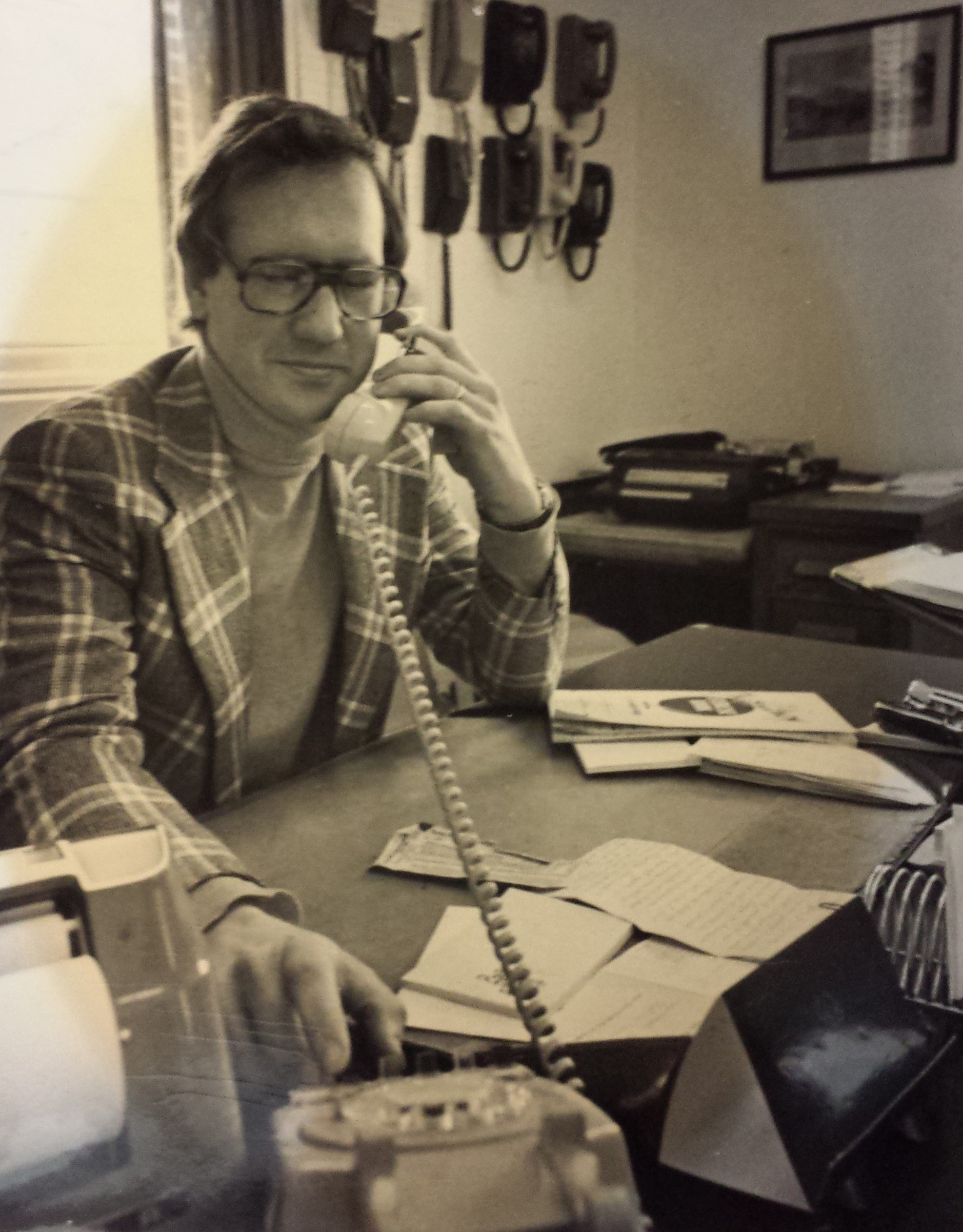 Keith Stevens on a phone call in the Thedford office.