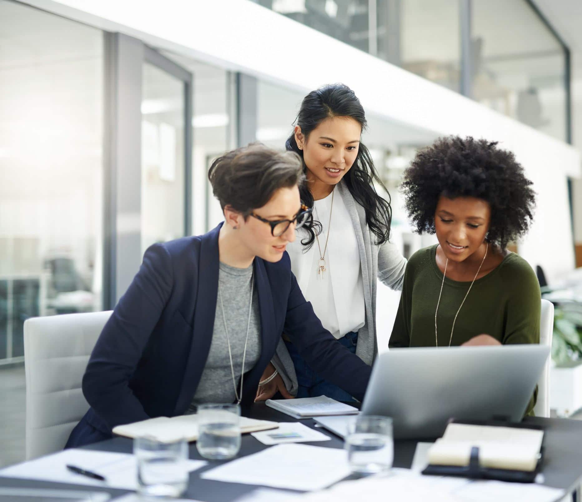 business women around laptop